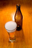 Beer glass and bottle — Stock Photo