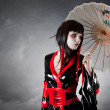 Modern style geisha in fetish kimono — Stock Photo