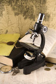 Research concept microscope and books — Stock Photo