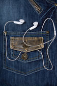 Blue jeans and headphones — Stock Photo