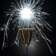 Celebration with champagne and fireworks — Stock Photo