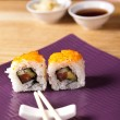 Sushi on the plate with chopstick - Stock Photo