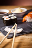 Sushi on the plate with chopstick — Stock Photo