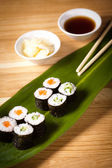 Sushi rolls on the leaf — Stock Photo