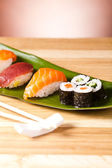Sushi and rolls on the leaf — Stock Photo