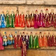 Stock Photo: Colorful handmade puppets on display for sale in Jaisalmer, Rajasthan. — Stock Photo