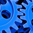 Stock Photo: Blue gears on black background