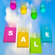 Colorful bags with balloons. sale. on sky background — Stock Photo #8481639