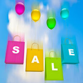 Colorful bags with balloons. sale. on sky background — Stock Photo