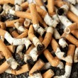 Stock Photo: Cigarette butts, background