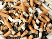 Cigarette butts, background — Stock Photo