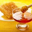 Spoon and honey comb — Stock Photo