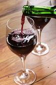 Pouring wine — Stock Photo