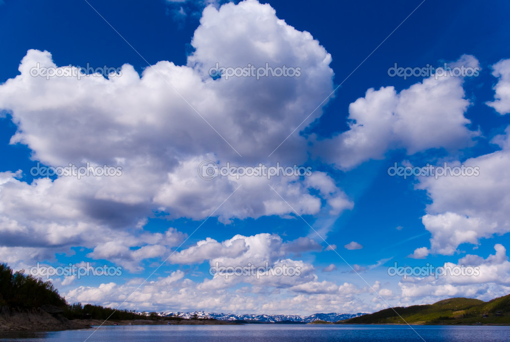 Sunny fjord in norway with a blue sky and friendly clouds — Stock Photo #8101004