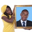 African woman holding a portrait of a businessman — Stock Photo
