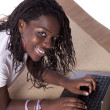 Young african woman working with her laptop — Stock Photo #8279217