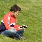 Reading at the park — Stock Photo