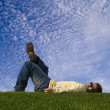 Young man lying down on the grass — Stock Photo #8279292