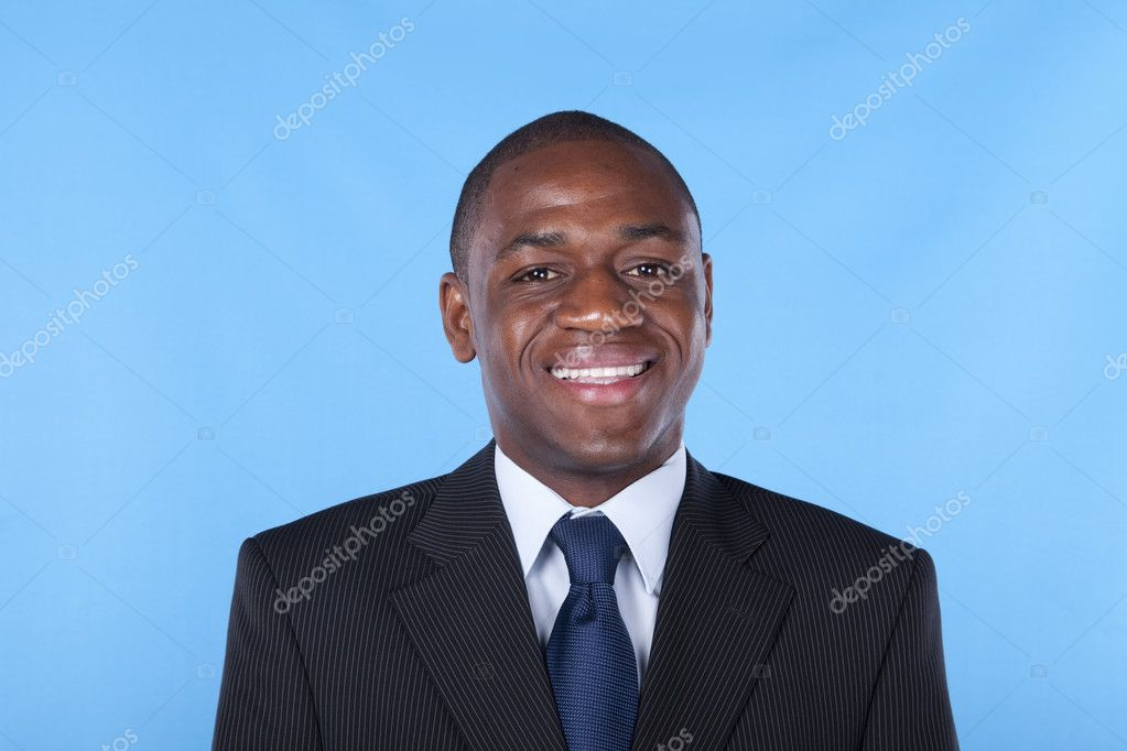 African businessman smiling with a blue background  Stock Photo #8289782