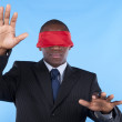 Blindfold african businessman — Stock Photo #8290077