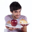 Young man food temptation — Stock Photo