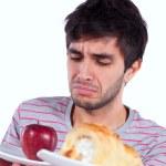 Young man food temptation — Stock Photo