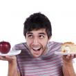 Young man food decision — Stock Photo
