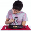 Man looking to a peanut — Stock Photo
