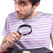 Man looking to a peanut — Stock Photo #8357265