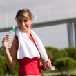Woman refreshing after the exercise — Stock Photo #8357875