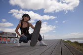 Cool skateboard woman — Stock Photo