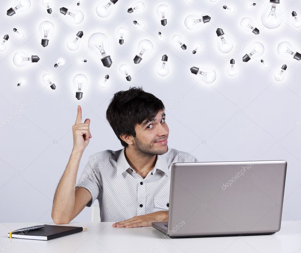 Young man with lots of ideas in the office working with his laptop — Stock Photo #8356748