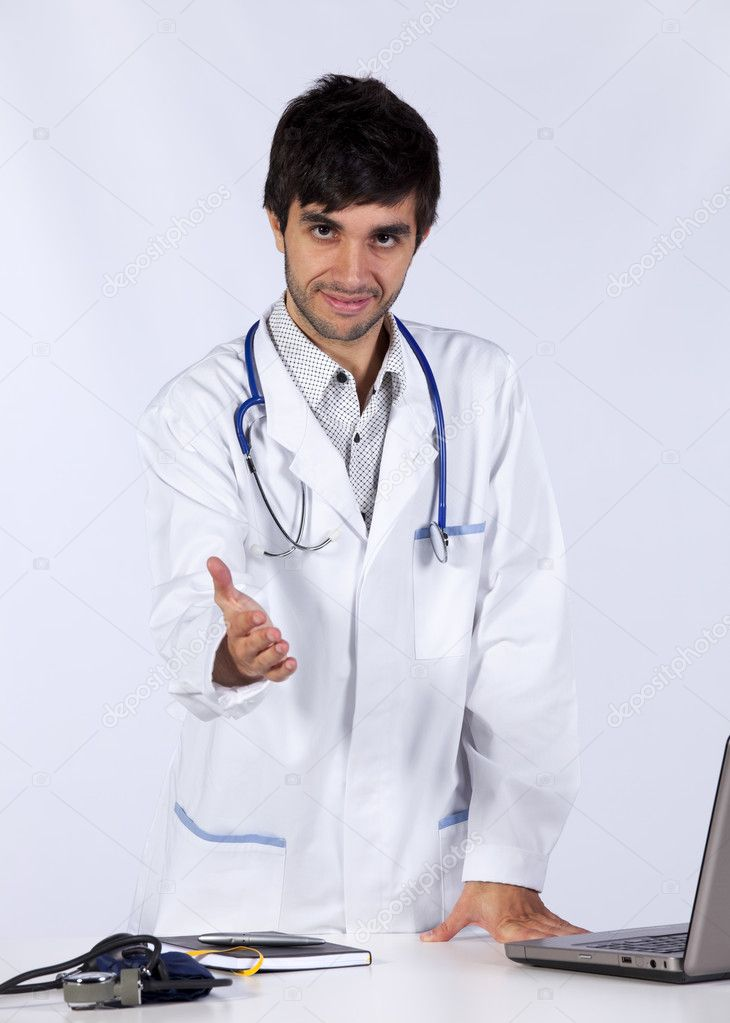 Happy young doctor at his office (isolated on white) — Стоковая фотография #8356923