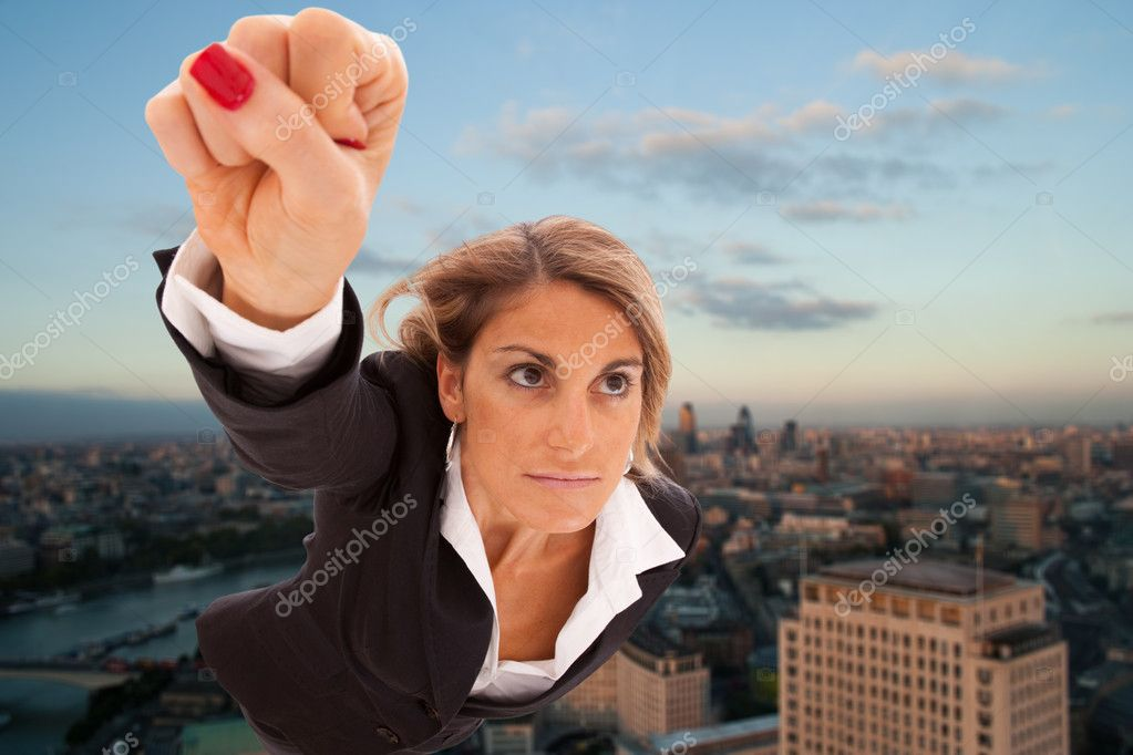 Super businesswoman flying over London city — Stock Photo #8358575