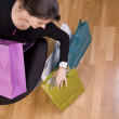 Woman showing her shopping bags — Stock Photo