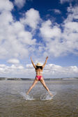 Jumping with a hat (motion blur) — Stock Photo
