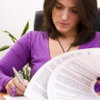 Stock Photo: Businesswomsigning documents