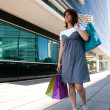 Happy woman after shopping — Stock Photo