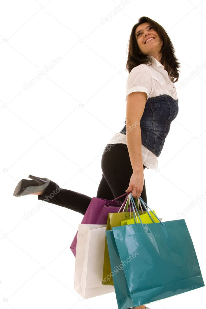 Happy beautiful woman with her shopping bags (isolated on white)  Stock Photo #8436469