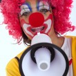 Funny clown with a megaphone — Stockfoto