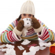 Stock Photo: Womwith flu symptoms drinking hot drink