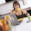 Modern woman reading e-mails at her breakfast — Stock Photo #8444375