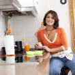 Woman eating her breakfast — Stock Photo #8444449
