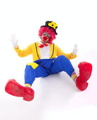 Funny clown on the floor — Stock Photo