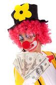 Funny clown holding money — Stock Photo