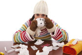 Woman with flu symptoms drinking a hot drink — Stock Photo