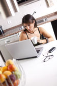 Modern woman reading e-mails at her breakfast — Foto Stock