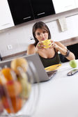 Modern woman reading e-mails at her breakfast — Foto de Stock