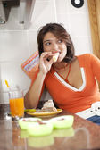 Woman eating her breakfast — Stok fotoğraf