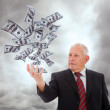 Stock Photo: Businessman holding money